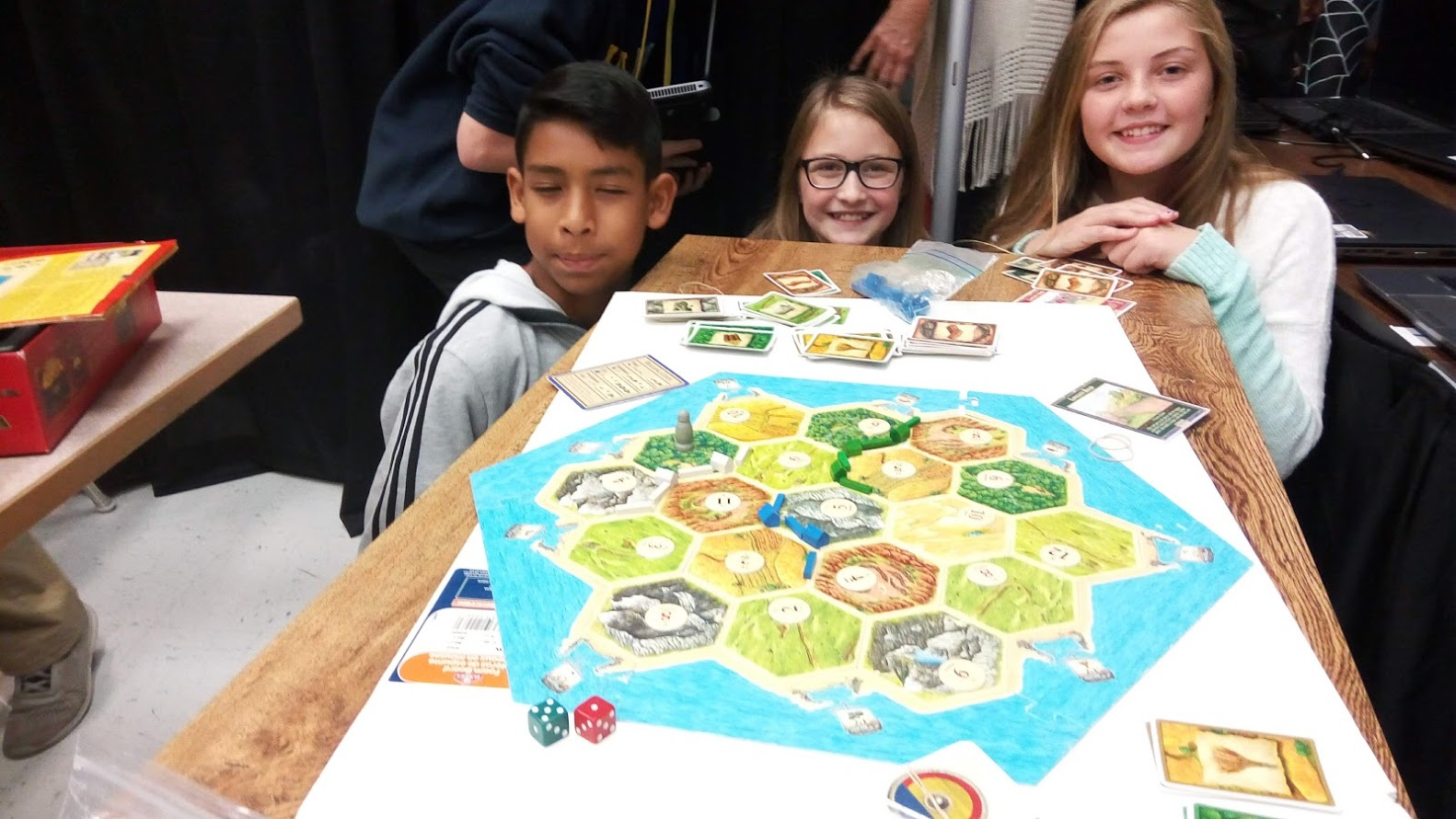 6th graders playing Settlers of Catan